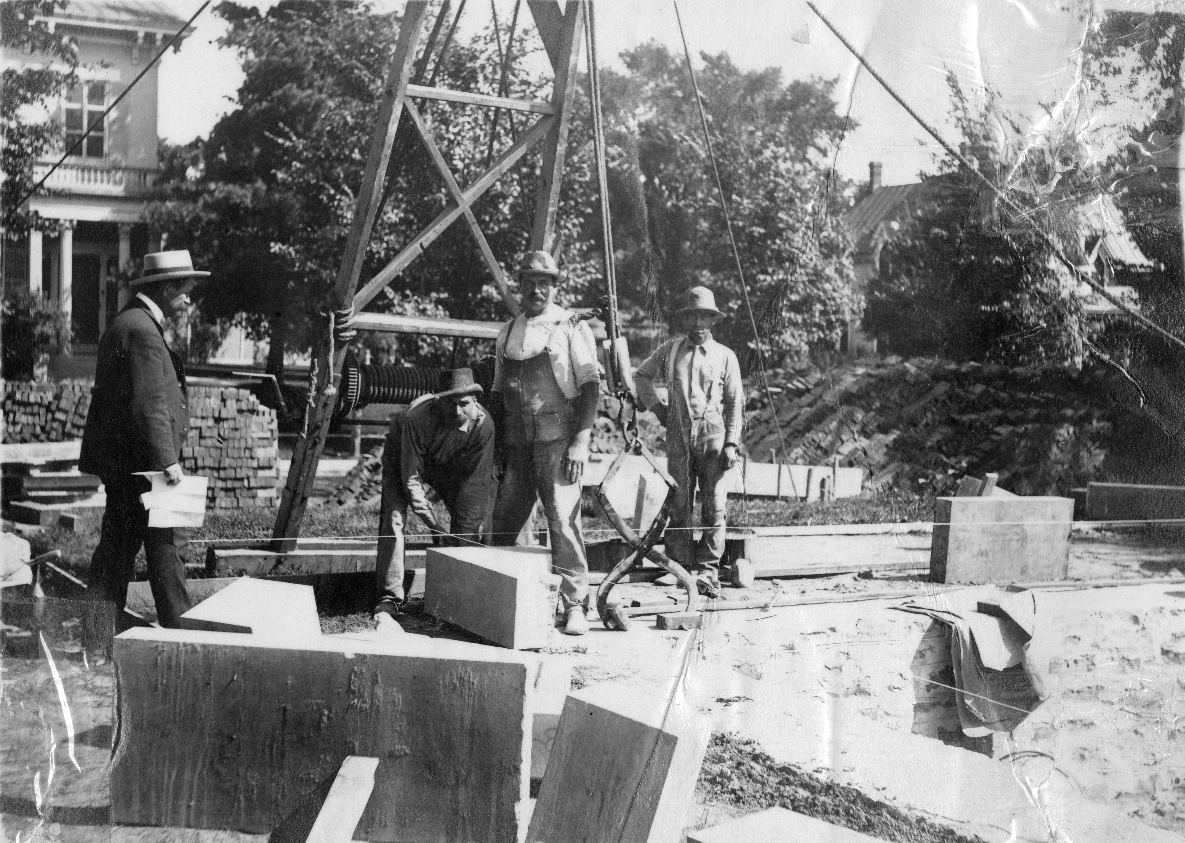 Workers laying bricks for the Carnegie building