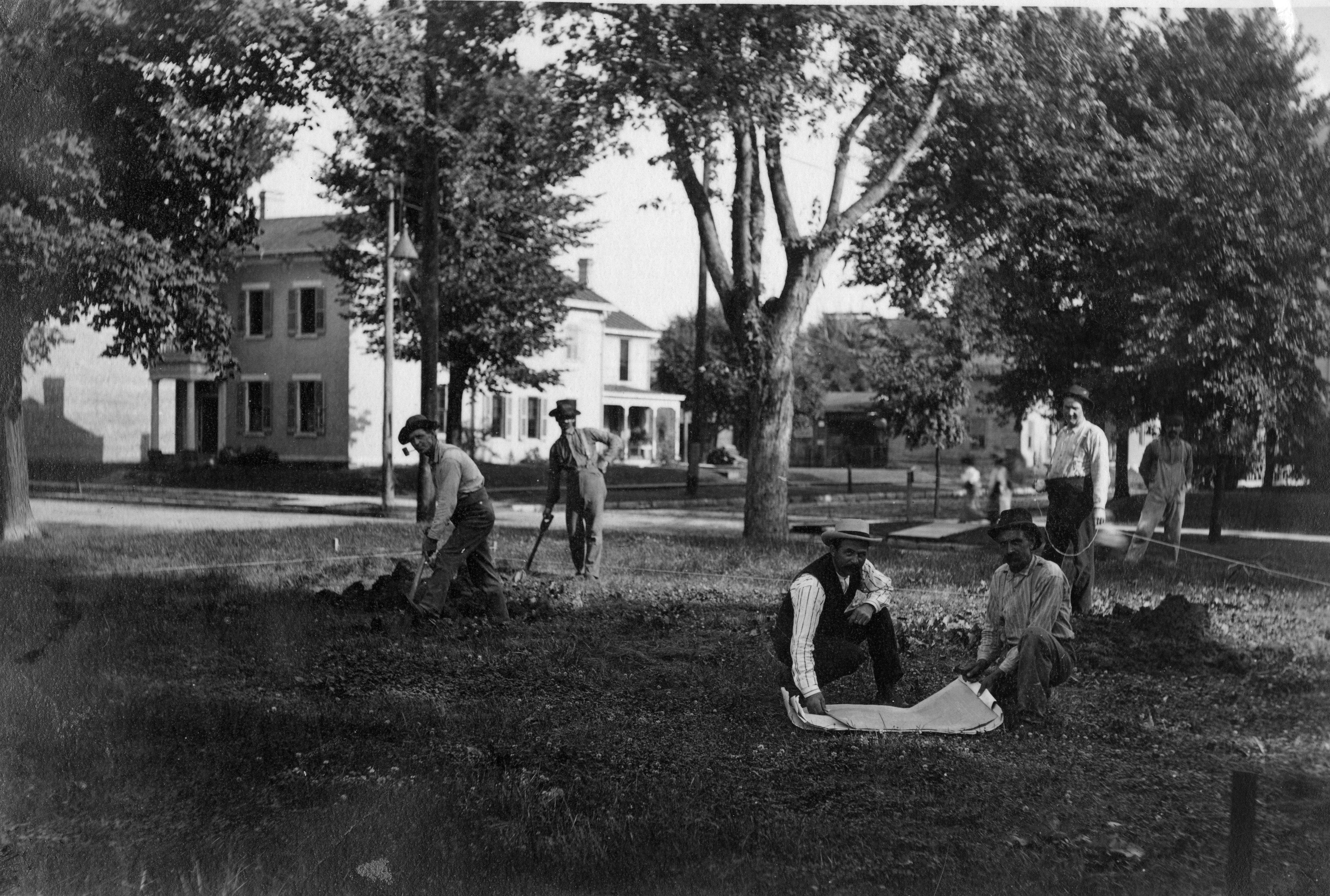 Workers laying the groundwork for the Carnegie building