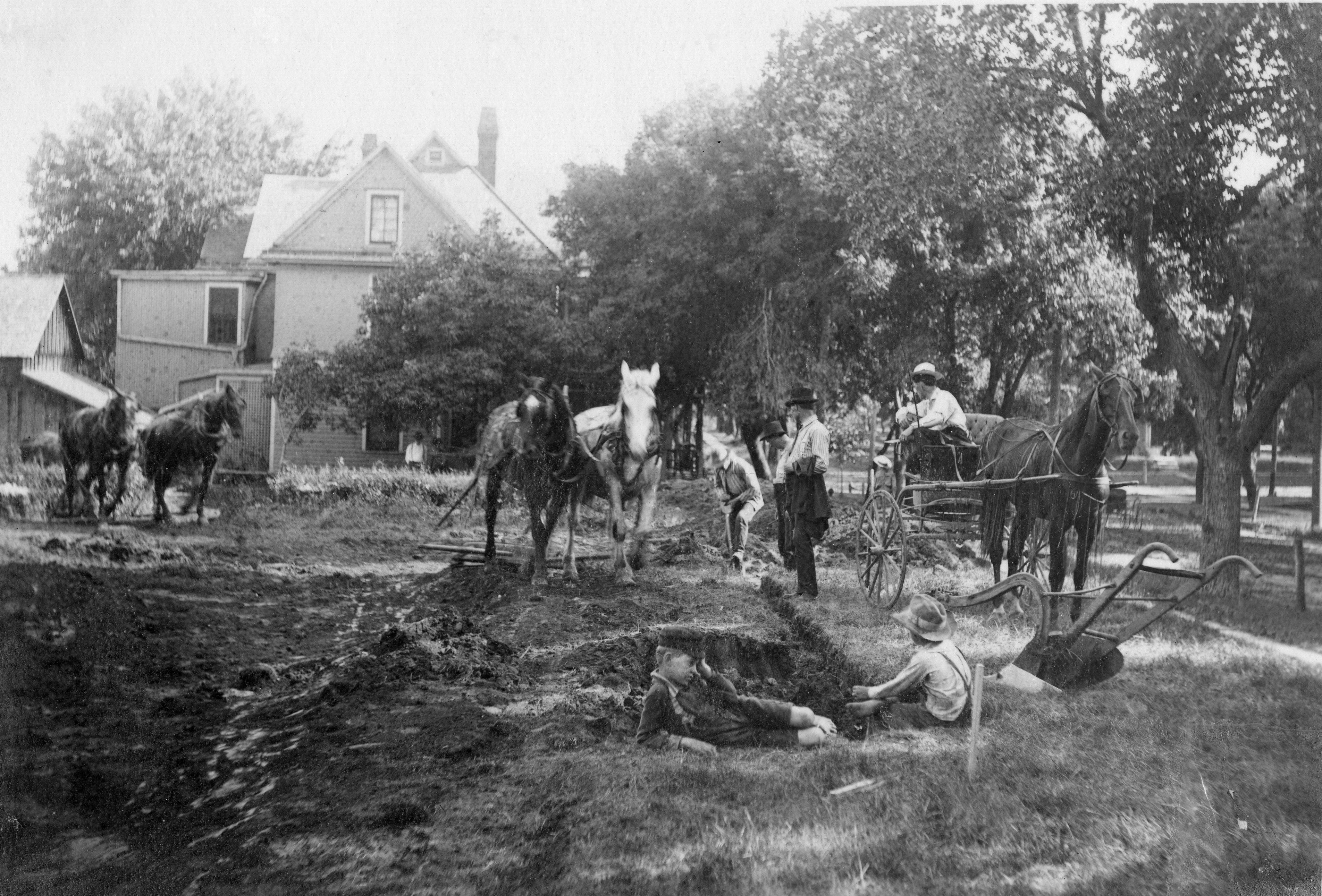 Horses and workers preparing the ground for construction