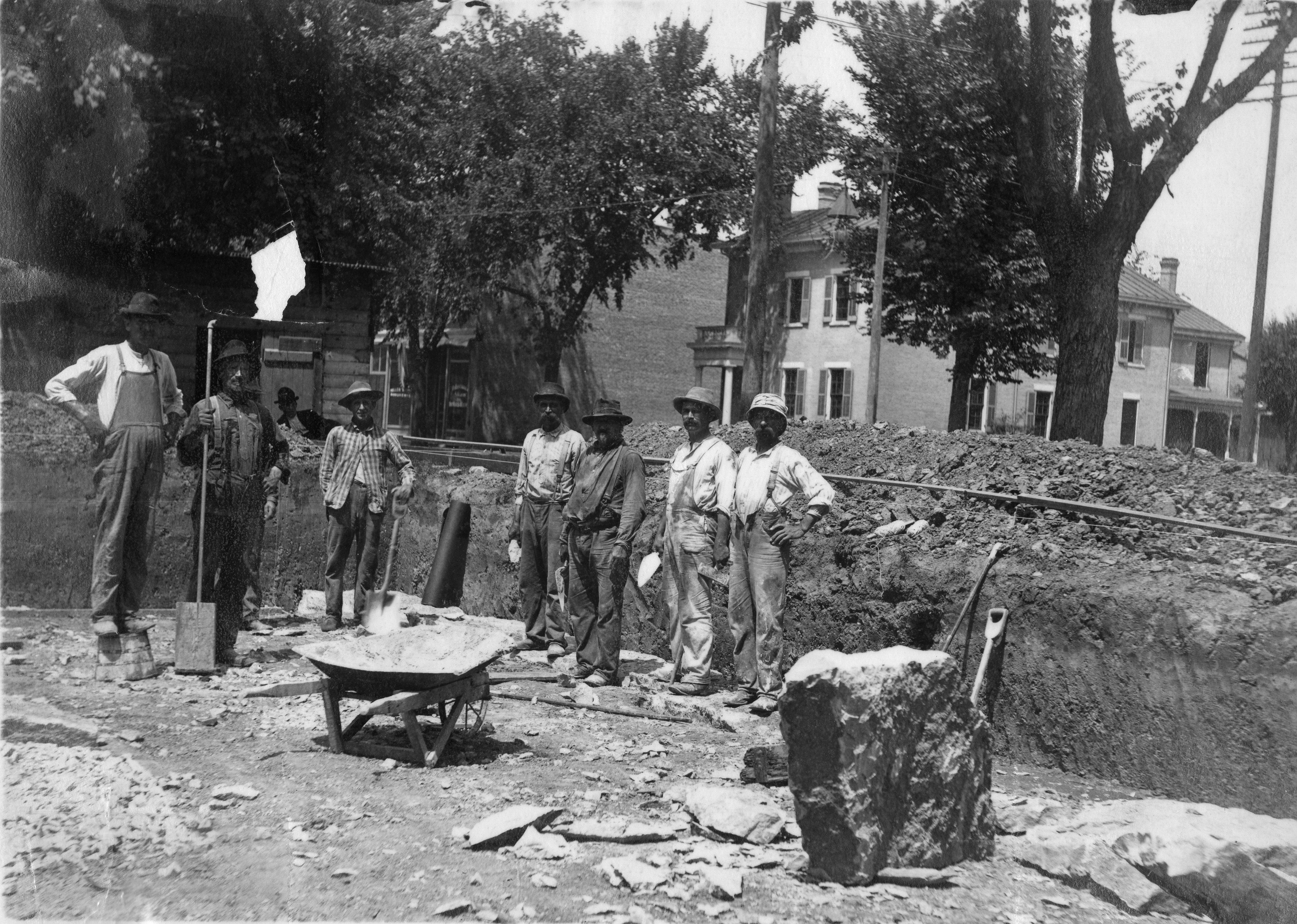 Workers pose in the dug out foundation of the Carnegie building