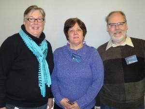Valeria Schnor, middle, was recently honored for 40 years of service with the Iowa City Public Library. She is congratulated by Library Director Susan Craig, left, and Library Board of Trustees Member Thomas Dean.