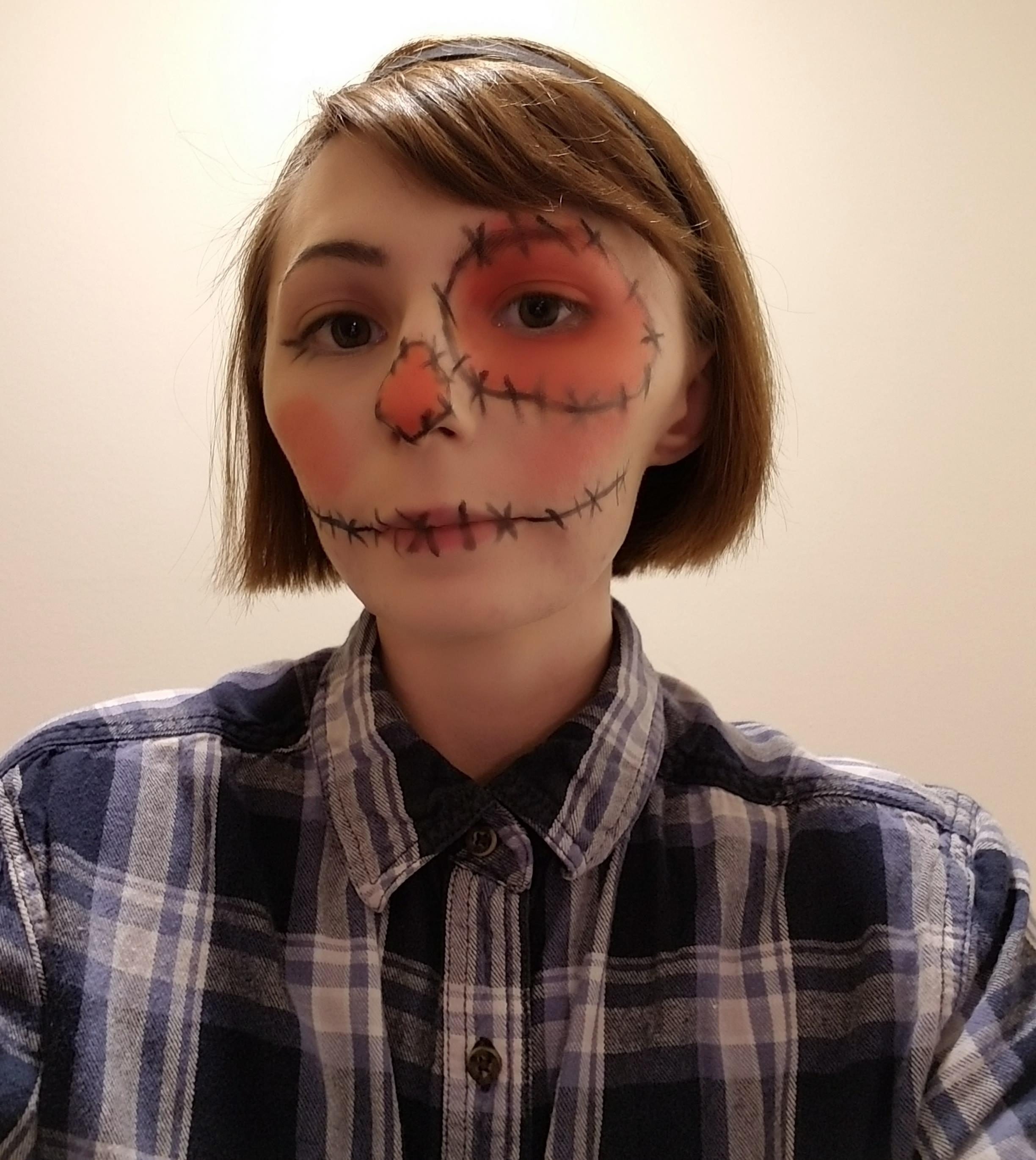 A photo of the author with makeup done to look like a scarecrow, taken for the tween makeup class.