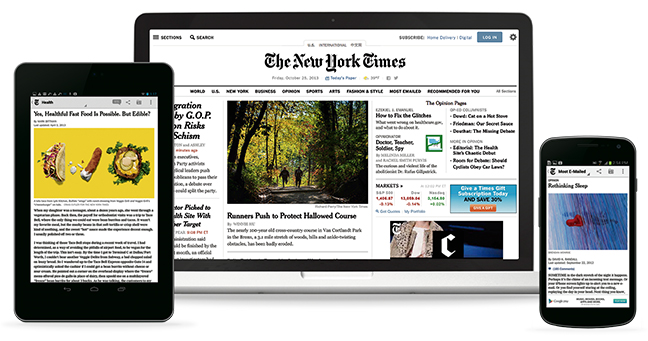 The New York Times website shown on a laptop, tablet and phone