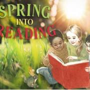 Children sitting reading in spring grass